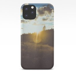 sunset slanted in a field iPhone Case