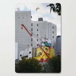 red crane on yellow Cutting Board