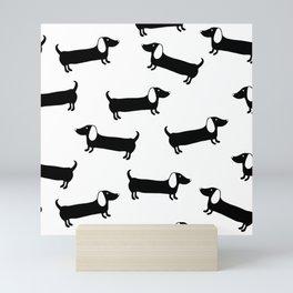 Cute dachshunds in black and white Mini Art Print