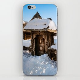 Traditional handcrafted gate and a rural Romanian homestead covered in snow iPhone Skin