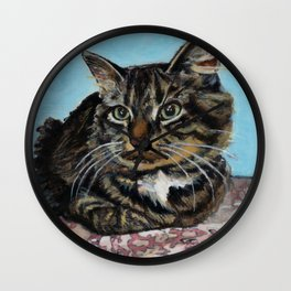 Siberian Cat sitting on Pink Floral Blanket Wall Clock