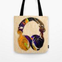 headphones Tote Bags featuring Headphones by marvinblaine