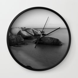 Stones in the sea 2 Wall Clock