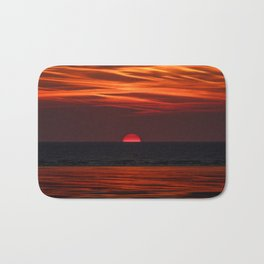 Beautiful image of the sun setting over the water Bath Mat