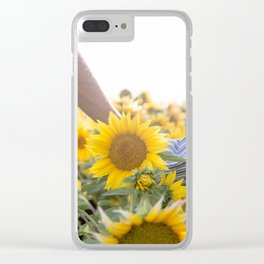 Couple holding hands in a sunflower field Clear iPhone Case