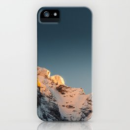 Last light before sunset on mountains iPhone Case