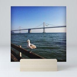 Seagull in front of San Francisco Bay Bridge Mini Art Print