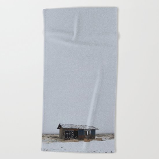 Hopeless, Abandoned, and Alone Under Grey Snow Filled Sky Beach Towel