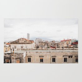 Naples rooftops with clouds Rug