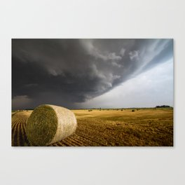 Spinning Gold - Storm Over Hay Bales in Kansas Field Canvas Print
