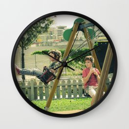 Brothers playing outdoors in the center of Milan in the autumn Wall Clock