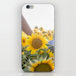 Couple holding hands in a sunflower field iPhone Skin