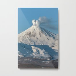 Top view of winter volcanic activity on sunny day with blue sky, steam and gas eruption from volcano Metal Print