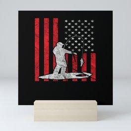 Ice fishing in front of American flag  Mini Art Print