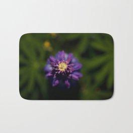 Purple Flower in a sea of green Bath Mat