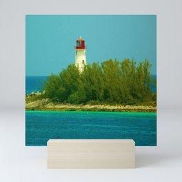 Lighthouse by the Ocean Mini Art Print