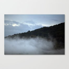 Hill between clouds and fog Canvas Print