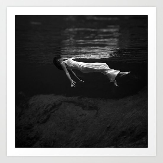 Underwater view of a woman floating in water Art Print