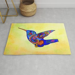 humming bird in color with green-yellow back ground Rug