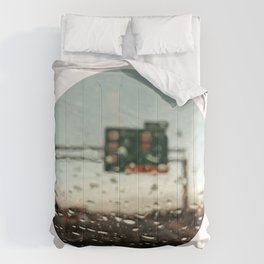 driving on a rainy day Comforters