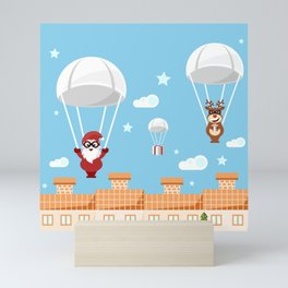 Santa Claus and reindeer parachutists delivering presents Mini Art Print