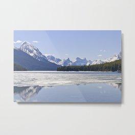 Rocky mountains reflecting in Maligne lake Metal Print