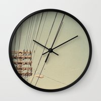 the wire Wall Clocks featuring wire by erinreidphoto