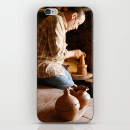 Potter working iPhone Skin