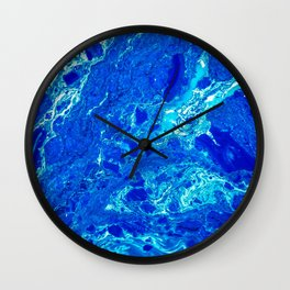 AN ABSTRACT PATTERN IN THE BLUE WATER SURFACE Wall Clock