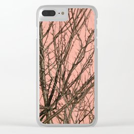 Bare tree against a pink wall Clear iPhone Case