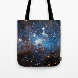 Large and Small Stars in Harmonious Coexistence Tote Bag