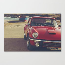 Triumph spitfire, english car by the beach in italy, old car and a boat, for man cave decor Canvas Print