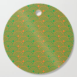 op art pattern retro circles in green and orange Cutting Board