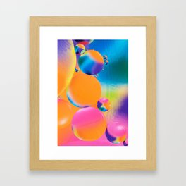Colorful close up of oil drops in water Framed Art Print