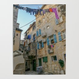 Little alley in the medieval center of the village Rovinji at sunset Poster