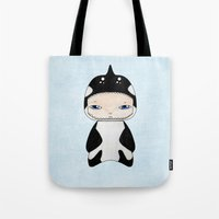 killer whale Tote Bags featuring A Boy - Killer Whale by Christophe Chiozzi