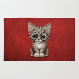 Cute Brown Tabby Kitten Wearing Eye Glasses on Red Rug