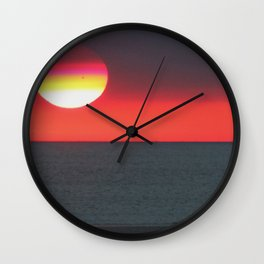 Mercury at Sunset Wall Clock