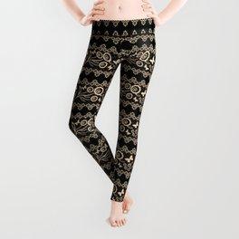 The lace pattern. Beige pattern on black background. Leggings