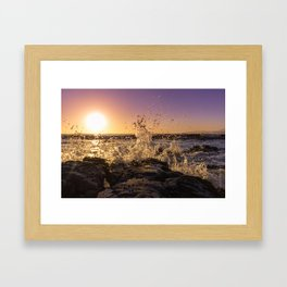 Magical sunset and waves breaking over rocky beach Framed Art Print