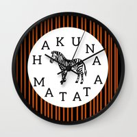 hakuna Wall Clocks featuring Hakuna Matata  by Shelby Thompson
