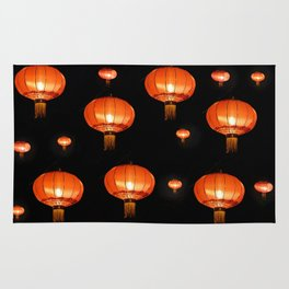 Orange chinese lampions with black background Rug