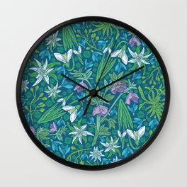 Edelweiss flowers with hellebore and snowdrops on blue background Wall Clock