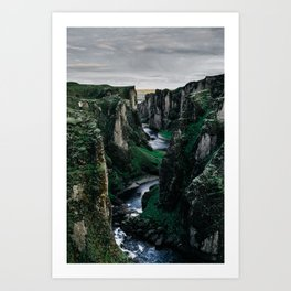 Fast flowing river making (wending) it's way between two massive rock formations Art Print