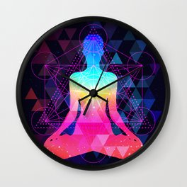 Human silhouette meditating or doing yoga. Metatrons Cube, Flower of life. Wall Clock