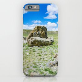 Tarkhatinsky megalithic complex. Steppe and blue mountains on the horizon. Altai Russia. iPhone Case