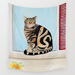 Cat sitting on window sill Wall Tapestry