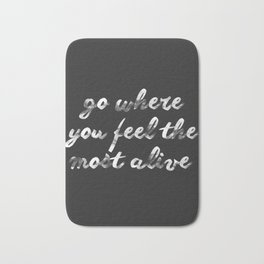 Go where you feel the most alive Bath Mat