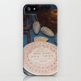 Belt buckles, iron musket bullets and perfume iPhone Case