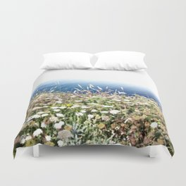 Flowers by the cliff Duvet Cover